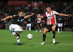 Javier Hernandez of West Ham United shapes o shoot as Kevin Dawson of Cheltenham Town closes in - Mandatory by-line: Paul Roberts/JMP - 23/08/2017 - FOOTBALL - LCI Rail Stadium - Cheltenham, England - Cheltenham Town v West Ham United - Carabao Cup
