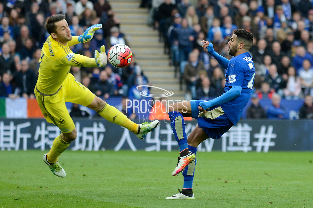 Swansea City goalkeeper Lukasz Fabianski palms the ball away from Leicester City midfielder Riyad Mahrez during the Barclays Premier League match between Leicester City and Swansea City at the King Power Stadium, Leicester, England on 24 April 2016. Photo by Alan Franklin.