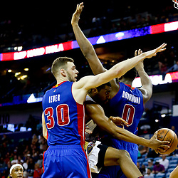 Mar 1, 2017; New Orleans, LA, USA; New Orleans Pelicans forward Solomon Hill (44) passes to forward Anthony Davis (23) as Detroit Pistons forward Jon Leuer (30) and center Andre Drummond (0) defend during the second half of a game at the Smoothie King Center. The Pelicans defeated the Pistons 109-86. Mandatory Credit: Derick E. Hingle-USA TODAY Sports