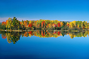 Ottawa River reflection in autumn colors<br /> Deux Rivieres<br /> Ontario<br /> Canada