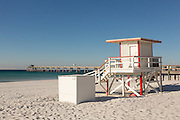 Lifeguard station and Okaloosa Island Pier along an empty beach in Fort Walton Beach, Florida.