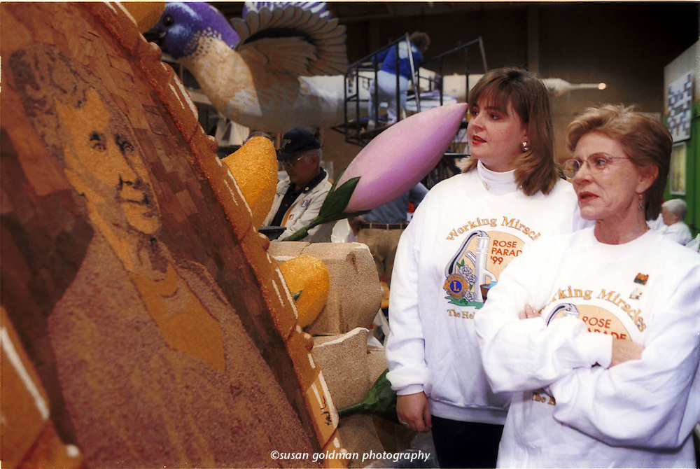 """Actress Patty Duke, right, and Keller Bane Johnson, great-grandniece of Helen Keller, view a portrait of Helen Keller made of seedlings, on the Lions Clubs International Rose Bowl Parade float, in Pasadena, Calif. Duke, who won an Oscar for her portrayal of Helen Keller in """"The Miracle Worker,"""" and the younger Keller will ride atop the Lions Club International float New Year's Day. Photo/Lions Clubs International, Susan Goldman."""