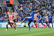 Leicester City defender Wes Morgan (5) with a shot during the Barclays Premier League match between Leicester City and Southampton at the King Power Stadium, Leicester, England on 3 April 2016. Photo by Simon Davies.