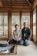Oiso, Kanagawa prefecture, Japan, February 10 2017 - Keiji and Atsuko Suzuki's minka, traditional wooden house, is the last minka home in Oiso. The previous owner of the 3,000 sq. ft. house moved it from the shores of Lake Biwa, near Kyoto, 35 years ago.<br /> Keiji and Atsuko Suzuki sitting in the detached house.