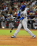 Sep. 27 2011; Phoenix, AZ, USA; Los Angeles Dodgers infielder Dee Gordon (9) hits a RBI single to left field during the seventh inning against the Arizona Diamondbacks at Chase Field.  Mandatory Credit: Jennifer Stewart-US PRESSWIRE.
