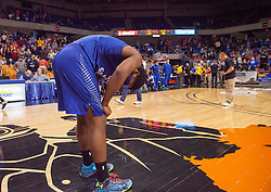 Fairmont Senior players react after losing to Poca for the Class AA championship game at the Charleston Civic Center.