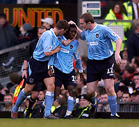 Photo. Jed Wee.<br /> Manchester United v Manchester City, FA Barclaycard Premiership, Old Trafford, Manchester. 13/12/03.<br /> Manchester City's Shaun Wright-Phillips (C) briefly gives City hope.