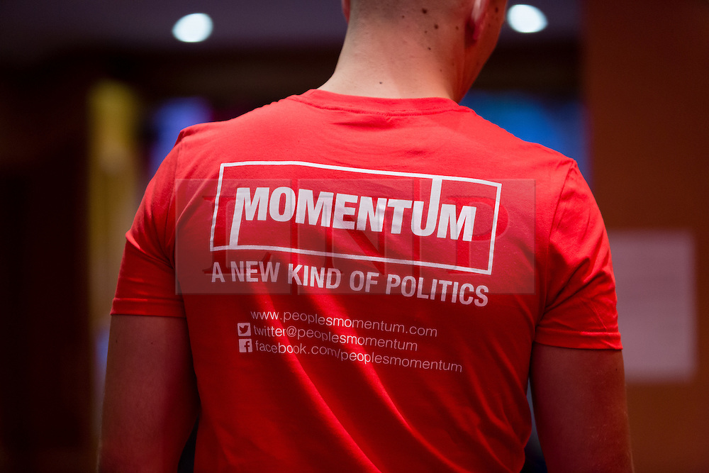 © Licensed to London News Pictures. 07/07/2016. LONDON, UK.  A supporter arrives in a Momentum tee shirt at a rally in support of keeping Jeremy Corbyn as the Labour party leader at the Troxy in east London on 6th July 2016. The event was organised by Momentum, a group of Labour Party supporters who are campaigning for Jeremy Corbyn to remain as leader of the Labour Party, following the recent resignation of many shadow cabinet MP's and the growing likelihood of a Labour Party leadership challenge..  Photo credit: Vickie Flores/LNP