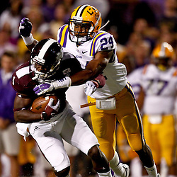 November 10, 2012; Baton Rouge, LA, USA;  LSU Tigers cornerback Tharold Simon (24) tackles Mississippi State Bulldogs wide receiver Chad Bumphis (1) during the first quarter of a game at Tiger Stadium.  Mandatory Credit: Derick E. Hingle-US PRESSWIRE
