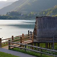Palafitte con lo sfondo del Lago di Ledro; Pile-Dwelling with Lake Ledro