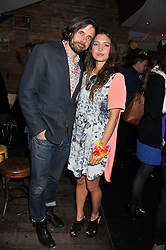 JOANNA BERRYMAN (interior designer who has designed the Rum Shack , previously married to Guy Berryman of Coldplay) and PHILIP BERGVIST at a party to celebrate the opening of the Rum Shack, Floridita, 100 Wardour Street, London on 1st February 2013.