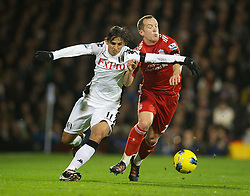 05.12.2011, Craven Cottage Stadion, London, ENG, PL, FC Fulham vs FC Liverpool, 14. Spieltag, im Bild Liverpool's Charlie Adam in action against Fulham's Bryan Ruiz during the football match of English premier league, 14th round, between FC Fulham and FC Liverpool at Craven Cottage Stadium, London, United Kingdom on 05/12/2011. EXPA Pictures © 2011, PhotoCredit: EXPA/ Sportida/ David Rawcliff..***** ATTENTION - OUT OF ENG, GBR, UK *****