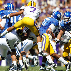 October 1, 2011; Baton Rouge, LA, USA;  LSU Tigers cornerback Tyrann Mathieu (7) strips the ball away fron Kentucky Wildcats quarterback Maxwell Smith (11) during the third quarter at Tiger Stadium. LSU defeated Kentucky 35-7. Mandatory Credit: Derick E. Hingle-US PRESSWIRE / © Derick E. Hingle 2011