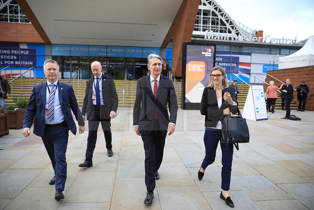 © Licensed to London News Pictures . 03/10/2017. Manchester, UK. Chancellor PHILIP HAMMOND at the start of day three of the Conservative Party Conference at the Manchester Central Convention Centre . Photo credit: Joel Goodman/LNP