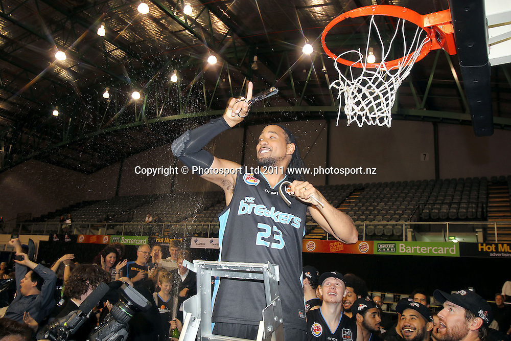Breakers' CJ Bruton cuts the net. iinet ANBL, Grand Final Game 3, New Zealand Breakers vs Cairns Taipans, North Shore Events Centre, Auckland, New Zealand. Friday 29th April 2011. Photo: Anthony Au-Yeung / photosport.co.nz