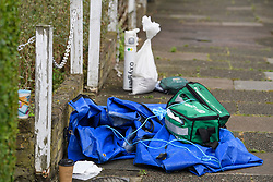 © Licensed to London News Pictures. 07/07/2019. London, UK.  Medical equipment at the entrance to a property in Enfield, North London, where a mother and three daughters, all under 12, have been stabbed by a man. The attacker is believed to be known to the victims. Photo credit: Ben Cawthra/LNP