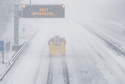 © Licensed to London News Pictures. 27/02/2018. New Hythe, UK.  A fire engine travels on an empty strech of the M20 as snow falls. Freezing temperatures and heavy snow are affecting large parts of Kent.  Photo credit: Peter Macdiarmid/LNP