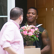 Reisterstown, MD -Ray Rice answers the door for a flower delivery man Tuesday Sept. 9th, 2014.