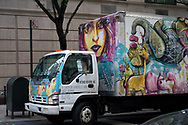Colorful truck owned by Intense Movers, Inc.