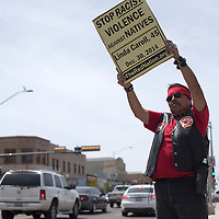 040415      Cayla Nimmo<br /> <br /> Mark Williams of the American Indian Movement, AIM, holds a sign calling for an end to racism against natives along Route 66 outside the Gallup Chamber of Commerce. Each sign used in the protest held the name of a native person who died of unnatural causes in Gallup and surrounding areas.