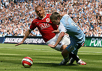 Photo: Paul Thomas.<br /> Manchester City v Manchester United. The Barclays Premiership. 05/05/2007.<br /> <br /> Wes Brown (L) of Utd tackles Michael Ball.