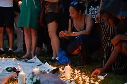 © Licensed to London News Pictures. 19/06/2017. London, UK.  Candles are lit during a vigil in Parliament Square to remember those who died in the Grenfell Tower fire in North Kensington of 14 June.  Mourners and wellwishers were given the opportunity to speak and to write messages on a community banner.  Photo credit : Stephen Chung/LNP