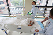SHANGHAI, CHINA - JUNE 09: (CHINA OUT)<br /> <br /> Siamese Twins Succeed In Separation With Help Of 3D Printed Model<br /> <br /> Siamese girl twins prepare to receive separation surgery at Children\'s Hospital of Fudan University on June 9, 2015 in Shanghai, China. Children\'s Hospital of Fudan University accepted their 8th operations of separation surgery on a pair of siamese girl twins. The seperation surgery focused on the haunches in lower bodies of siamese twins and gained success with the help of 3D printed model which recovered body fabric of the twins in same proportion for medical workers\' accurate reference. It was said that it\'s first time that Children\'s Hospital of Fudan University applied 3D skills on separation surgery and the siamese girl twins were in good condition in their 80 days after birth<br /> ©Exclusivepix Media