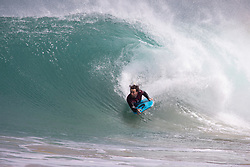© Licensed to London News Pictures. 22/05/2020. Padstow, UK. A bodyboarder catches a wave near Padstow, Cornwall. There is currently no RNLI Lifeguard service in the county due to Coronavirus (Covid-19), potentially causing issues as a large swell and warm weather is expected during the upcoming bank holiday weekend. Photo credit : Tom Nicholson/LNP