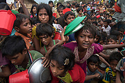 November 16, 2017. Rohingya refugees, mainly children, wait to receive aid as food is distributed at the Moynarghung Distribution Centre in Thaingkhali. Photograph by David Dare Parker