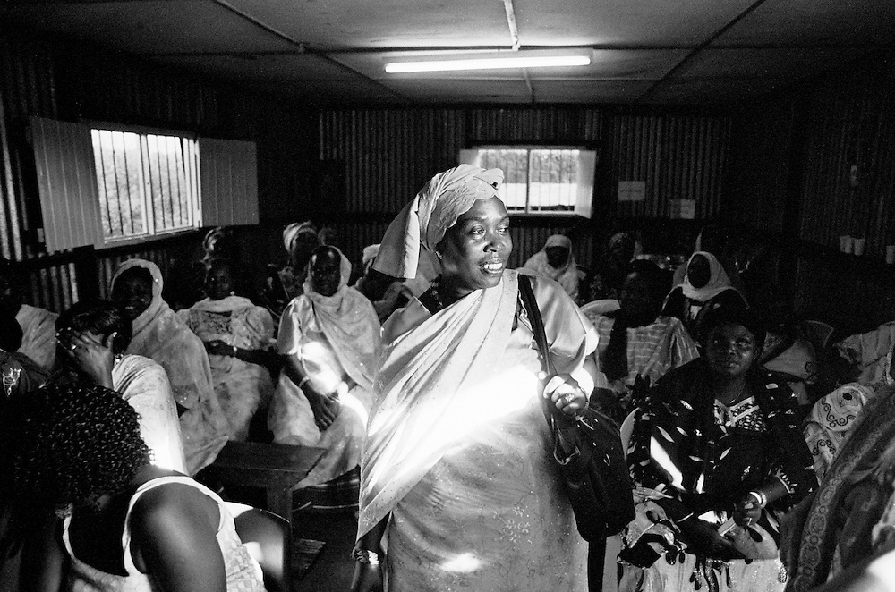 A Nubian women's group meets to raise funds for their programs. Nubian women take great pride in their community and feel it is essential to the community's future to preserve and promote Nubian culture and traditions.  The hall is in an area that is now called Karanja, but used to be known to the Nubians as Salama.  Many Nubians still refer to it that way.