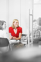 Office workers sitting around conference table (isolated colour)