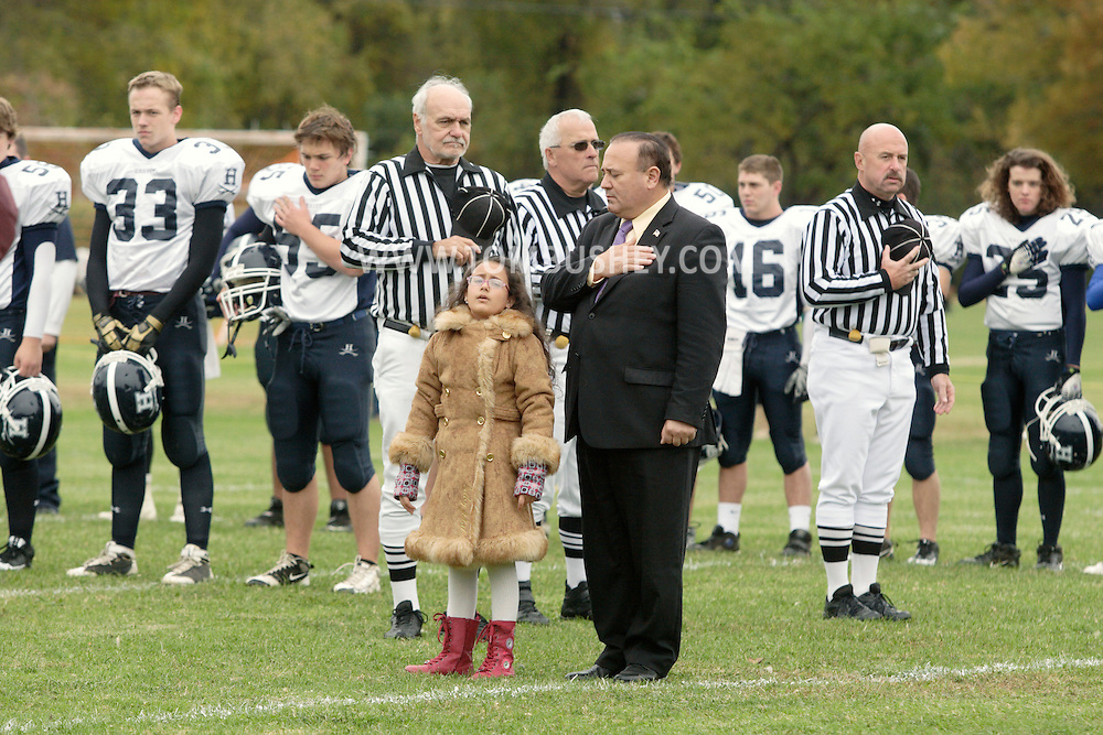 Cornwall-on-Hudson, New York - A young girl sings the National Anthem before New York Military Academy plays the Harvey School in a football game on Oct. 17, 2009.