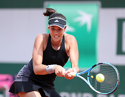 May 31, 2018 - Paris, France -GARBINE MUGURUZA of Spain hits a return during the women's singles second round match against Fiona Ferro of France at the French Open Tennis Tournament 2018 in Paris, France. Muguruza won 6:4, 6:3. (Credit Image: © Luo Huanhuan/Xinhua via ZUMA Wire)