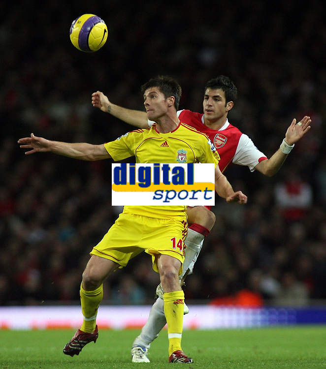 Photo: Paul Thomas.<br /> Arsenal v Liverpool. The Barclays Premiership. 12/11/2006.<br /> <br /> Liverpool's Xabi Alonso tries to keep away from Francese Fabregas.