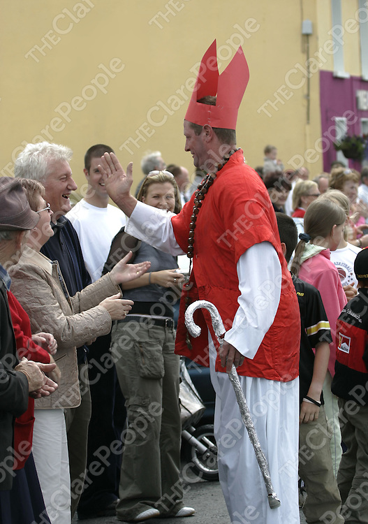 Tom Morrssey, AKA the Pope, blesses a member of the public while taking part in the Rose of Clare in Cree Co Clare.<br />