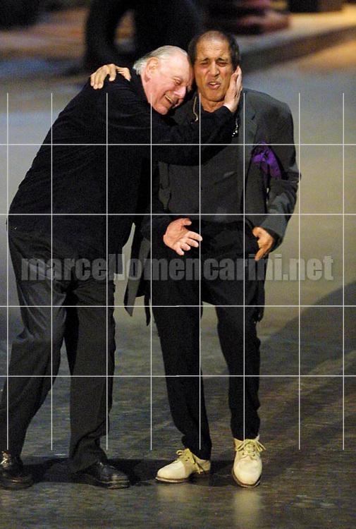 """Milan, May 4, 2001. Dario Fo and Adriano Celentano on the set of tv program """"125 Milioni di Cazzate"""" / Milano, 4 maggio 2001. Dario Fo e Adriano Celentano sul set del programma televisivo """"125 milioni di cazzate"""" -  © Marcello Mencarini"""