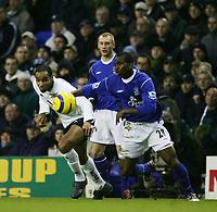 FREDERIC KANOUTE HOLDS OF JOSEPH YOBO-BARCLAYS PREMIERSHIP SATURDAY 01 Jan 2005-Tottenham v Everton-COLORSPORT/KIERAN GALVIN