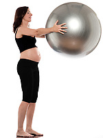 pregnant caucasian woman exercise with fitness ball isolated studio on white background