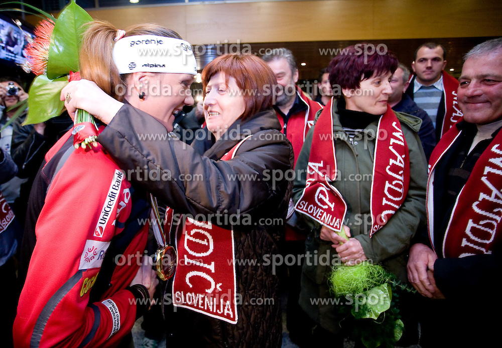 Slovenian athlete Petra Majdic celebrates with her mother when she arrived home with cristal globus at the end of the nordic season 2008/2009, on March 23, 2009, at airport Jozeta Pucnika, Brnik, Slovenia. (Photo by Vid Ponikvar / Sportida)