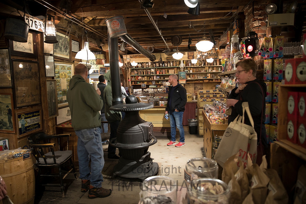 Shoppers in traditional and quaint Vermont Country Store buying food, souvenirs and gifts in Weston, Vermont, New England, USA