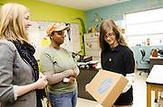 Seventh-grader Samantha Zinn receives her new laptop from her teacher Kellie Karavias and Nutrition Services Dietitian Jennifer Lengyel.