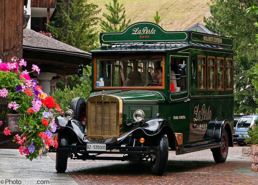 La Perla Dolomiti Express restored bus at Corvara in Badia, Dolomites, Italy. Corvara is a prestigious tourist center in Alta Badia, at the top of Val/Valle/Valley of Badia in the province of Südtirol/South Tyrol/Alto Adige, Italy. Corvara is surrounded by the peaks of the Dolomites (or Dolomiti), a part of the Southern Limestone Alps in Europe. The Dolomites were declared a natural World Heritage Site (2009) by UNESCO.