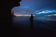 Fisherman under Boca de Cangrejos Brigde in Carolina, Puerto Rico