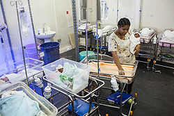 A nurse takes care of babies in neonatology ward at MSF's Centre de Référence en Urgence Obstétricale (CRUO) in Port-au-Prince, Haiti, October 16, 2015.