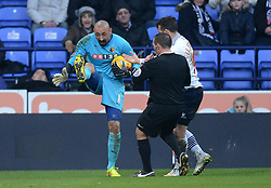Watford's Heurelho Gomes' protests about a high boot - Photo mandatory by-line: Richard Martin-Roberts/JMP - Mobile: 07966 386802 - 14/02/2015 - SPORT - Football - Bolton - Macron Stadium - Bolton Wanderers v Watford - Sky Bet Championship