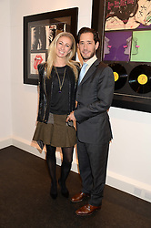 RYAN PRINCE and his wife JENNY HALPERN-PRINCE at a private view of work by Andy Warhol at The Little Black Gallery, Park Walk, London SW10 on 22nd October 2013.