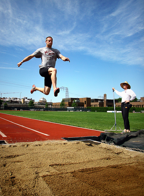 2007 Big Ten Field Event Athlete of the Year Derek Gearman practices for the upcoming Outdoor Championships as head coach Phil Lundin analyzes his long jump form.