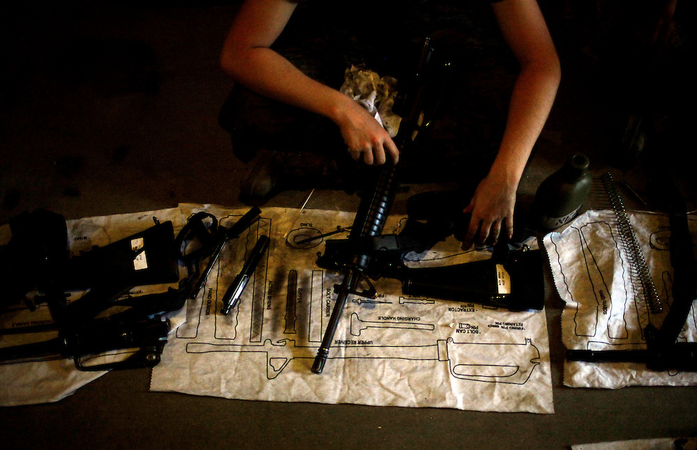 Elaine Neal follows the diagram on taking apart, cleaning and reassembling her M16A2 rifle while in one of the sea huts on Parris Island during her basic trainging on Sept. 29, 2009. Greg Kahn/Staff