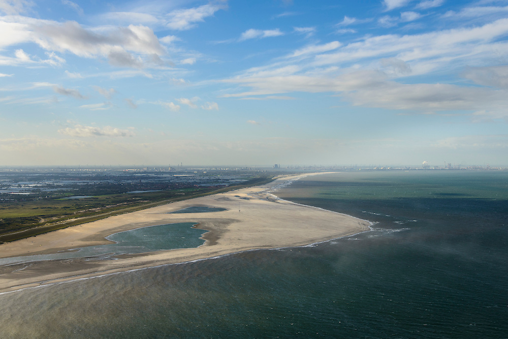 Nederland, Zuid-Holland, Gemeente Westland, 23-10-2013; Delflandse Kust ter hoogte van Ter Heijde en Monster, Hoek van Holland en Maasvlakte aan de horizon. Zandmotor, aanleg van kunstmatig schiereiland door het opspuiten van zand voor de kust. Wind, golven en stroming zullen het zand langs de kust verspreiden waardoor breder stranden en duinen ontstaan. De zandmotor is een experiment in het kader van kustonderhoud en kustverdediging. In de achtergrond de kassen van het Westland.<br /> Sand Engine, construction of artificial peninsula by the raising of sand for the coast of Ter Heijde (near the Hague). Wind, waves and currents will distribute the sand along the coast yielding wider beaches and dunes along the coastline. The Sand Engine is a experiment for coastal maintenance of coastal defense. In the background the Westland greenhouses.<br /> luchtfoto (toeslag op standard tarieven);<br /> aerial photo (additional fee required);<br /> copyright foto/photo Siebe Swart
