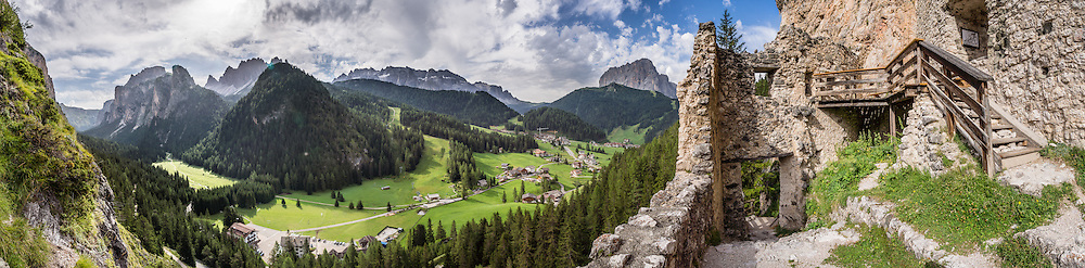 Wolkenstein Castle was built in the 1200s, was named for a 1400s troubadour, collapsed in 1525 AD, was rebuilt but then fell into disrepair. Vallunga/Langental valley makes a perfect walking destination in Puez-Geisler Nature Park, in Val Gardena, Dolomites, South Tyrol, Italy, Europe. The beautiful ski resort of Selva di Val Gardena (German: Wolkenstein in Gröden; Ladin: Sëlva Gherdëine) makes a great hiking base in the Dolomites, in the South Tyrol region (Trentino-Alto Adige/Südtirol) of Italy, Europe. For our favorite hike in the Dolomiti, start from Selva with the first morning bus to Ortisei, take the Seceda lift, admire great views up at the cross on the edge of Val di Funes (Villnöss), then walk 12 miles (2000 feet up, 5000 feet down) via the steep pass Furcela Forces De Sieles (Forcella Forces de Sielles) to beautiful Vallunga (trail #2 to 16), finishing where you started in Selva. The hike traverses the Geisler/Odle and Puez Groups from verdant pastures to alpine wonders, all preserved in a vast Nature Park: Parco Naturale Puez-Odle (German: Naturpark Puez-Geisler; Ladin: Parch Natural Pöz-Odles). UNESCO honored the Dolomites as a natural World Heritage Site in 2009. This panorama was stitched from 12 overlapping photos.
